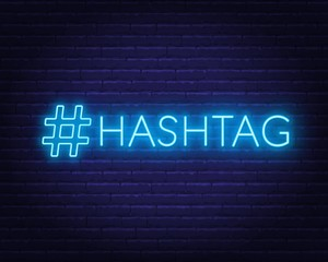 Neon hashtag sign on brick wall background. Vector illustration.