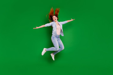 Wall Mural - Full length body size view portrait of her she nice-looking attractive lovely cheerful cheery girl having fun freedom isolated over bright vivid shine green background