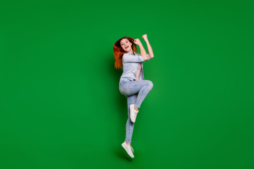 Wall Mural - Full length body size view portrait of her she nice-looking attractive lovely slim cheerful cheery girl having fun day time holiday dance isolated over bright vivid shine green background