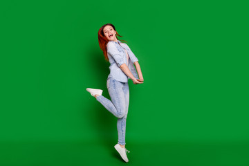 Wall Mural - Full length body size view portrait of her she nice attractive lovely winsome slim fit thin cheerful cheery optimistic girl having fun isolated over bright vivid shine green background