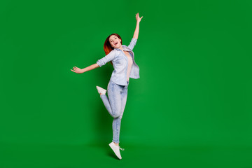 Wall Mural - Full length body size view portrait of her she nice attractive slim fit thin cheerful cheery optimistic overjoyed girl having fun free time isolated over bright vivid shine green background