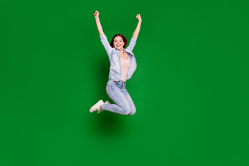 Wall Mural - Full length body size view portrait of nice-looking attractive lovely slim fit thin sporty cheerful cheery girl having fun raising hands up isolated over bright vivid shine green background