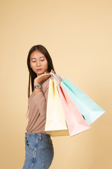 Young Asian woman happy with shopping bag.