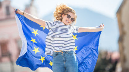 Attractive happy young girl with the flag of the European Union Fotomurales