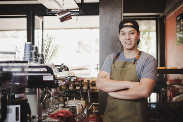 Portrait man barista in cafe.
