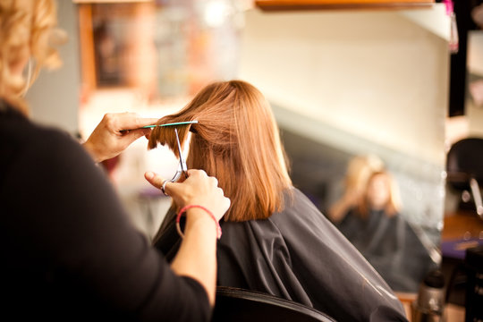 Red-Haired Girl Getting Haircut in Hair Salon