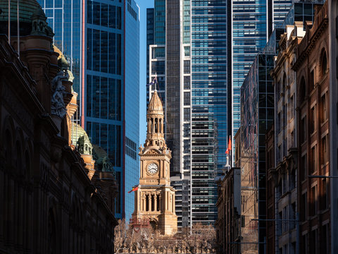 Closeup of an old building in the middle of tall business buildings in downtown Sydney