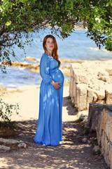 pregnant redhead woman