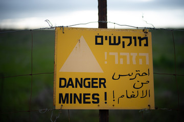 A warning sign for mines in the Golan Heights near the Syrian border