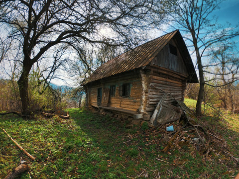 Pictorial landscape old dilapidated wooden small house