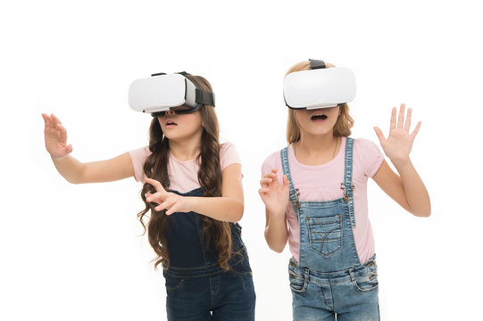 Virtual reality is exciting. Girls little kids wear vr glasses white background. Virtual education concept. Modern life. Interaction in virtual space. Cyber gaming. Augmented reality technology