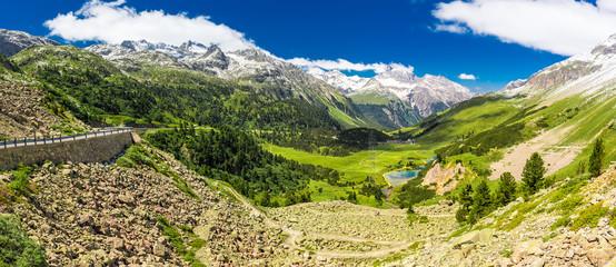 Wall Mural - Mountain road to Albula pass - Swiss mountain pass near Sankt Moritz in the canton of Graubunden. Switzerland