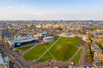 Wall Mural - Aerial view of the Van Gogh Museum in Amsterdam by the beautiful  Vondelpark. View from above.