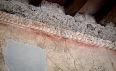 Ancient walls with preserved paint