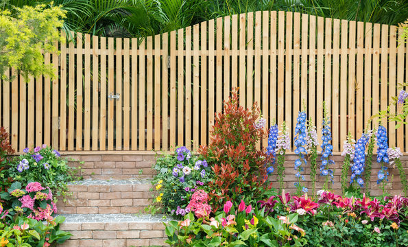 entrance and wooden fence of backyard flower garden