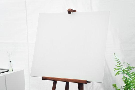 empty canvas board in white room