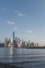 Fototapeta Skyline of downtown  Manhattan of New York City at dusk, viewed from New Jersey, USA
