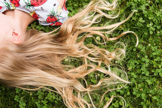 Close up of girl's hair in grass