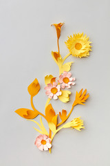 Summer yellow wildflowers handmade of colofrul paper on a light