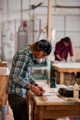 Woodworking: Artist Working On Cabinet Trim