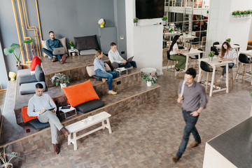 People working separately in the co-working office space