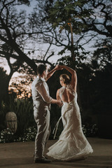 Wedding Couple Having First Dance at Night Outdoors