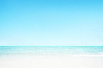 The blur cool sea background on horizon tropical sandy beach; relaxing outdoors vacation with heavenly mind view at a resort.