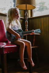Young Singer Seated on Red Chair