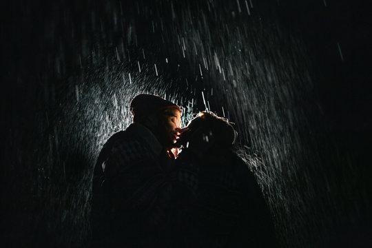 couple kissing under the rain