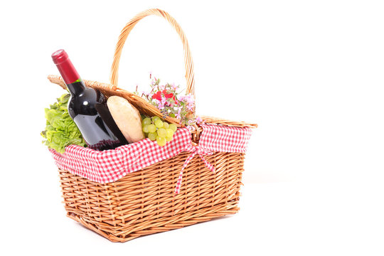 picninc basket with wine, cheese and fruit