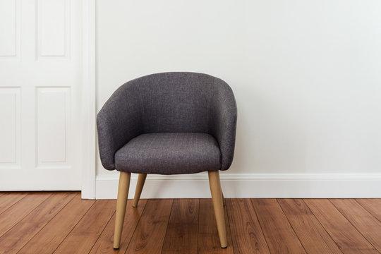 tub chair against plain wall