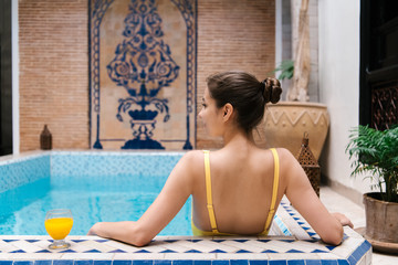 Woman chilling in pool with drink
