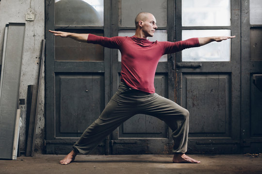 Man stretching while doing yoga