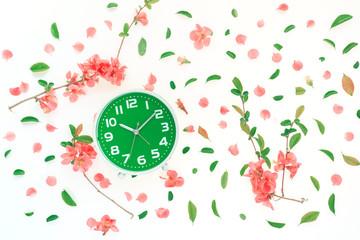 Vintage alarm clock flat lay with colorful springtime decoration
