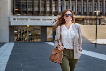 Happy mature woman walking confidently