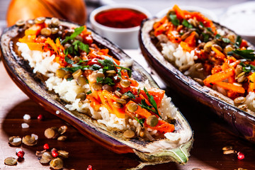 Stuffed aubergine with rice and vegetables