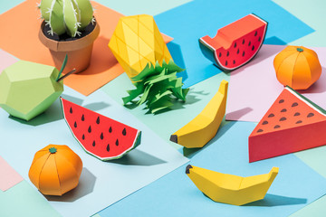 handmade cardboard fruits and cactus on multicolored paper