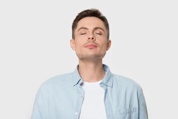 Fototapeta Calm Caucasian man breath deep enjoying pleasant smell