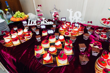 a large assortment of muffins. wedding reception.