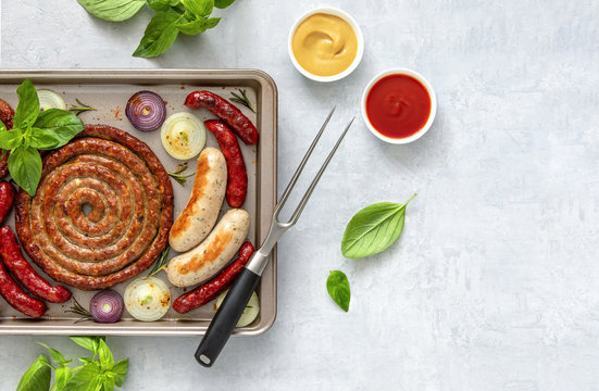 Oven roasted sausages in a sheet pan, view from above