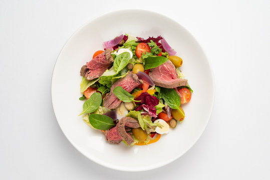 Thai grilled beef salad on the white plate