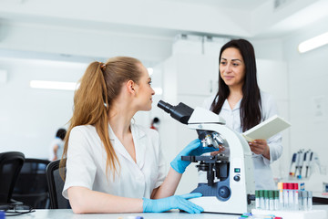Scientist researcher using microscope in laboratory. Medical healthcare technology and pharmaceutical research and development concept