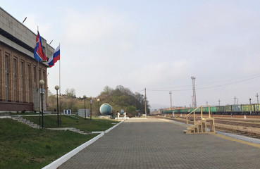 State flags of North Korea and Russia fly at a railway station in Khasan