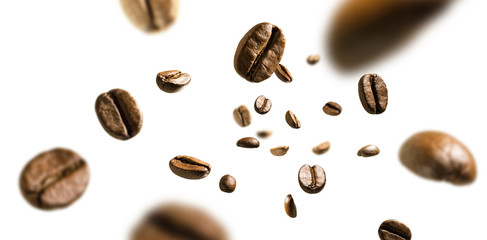 Poster de jardin Café en grains Coffee beans in flight on white background