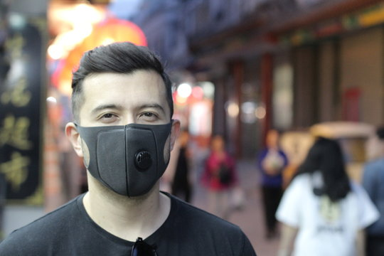 Urban picture of young man with pollution mask