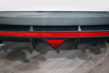 Modern sport car rear bumper skirt with reflector