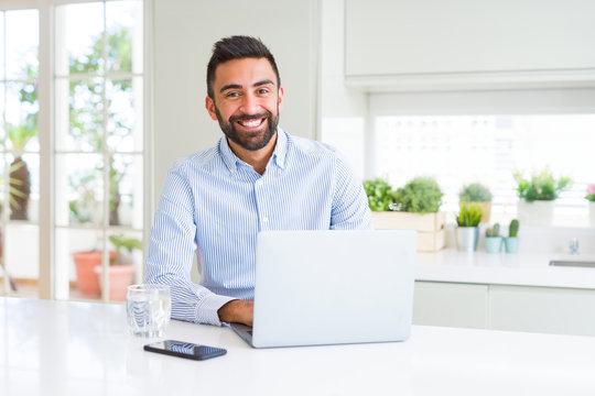 Business man smiling working using computer laptop
