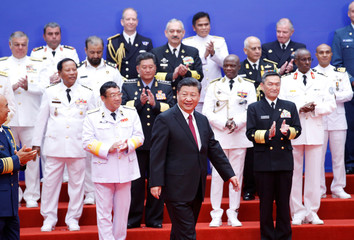 Chinese President Xi Jinping poses for a group photo with international navy delegates in Qingdao