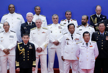 International navy delegates wait for a group photo with Chinese President Xi Jinping in Qingdao