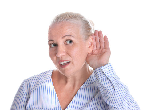 Mature woman with hearing problem on white background